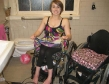wet wheelchair girl transfering into another chair