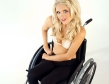 blonde wheelchair babe in sexy white bra and black leggings