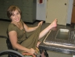 wheelchair babe spreading leg up doing splits