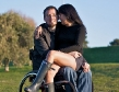 wheelchair couple embrace girlfriend lap