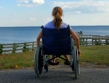 wheelchair spinal cord injury teen looking out to sea