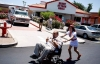 Heart Attack Grill nurse pushing happy quadruple bypass burger patient to his car in a wheelchair