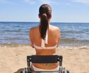 We want you to name this beach wheelchair girl image