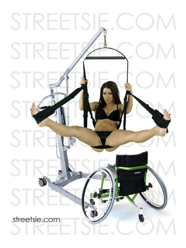 Sexy wheelchair lover spread legs in love swing suspended by personal patient hoist