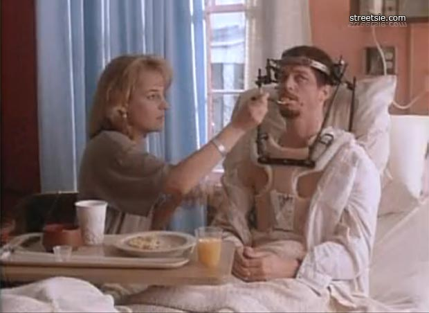 Helen Hunt with spoon & Joel Garcia in halo brace meal time at the rehab hospital spinal injury unit ward