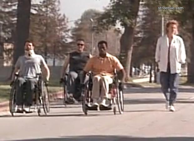 Eric Stoltz left William Forsythe and Wesley Snipes with nurse pushing wheelchairs down street in The Waterdance spinal cord injury movie