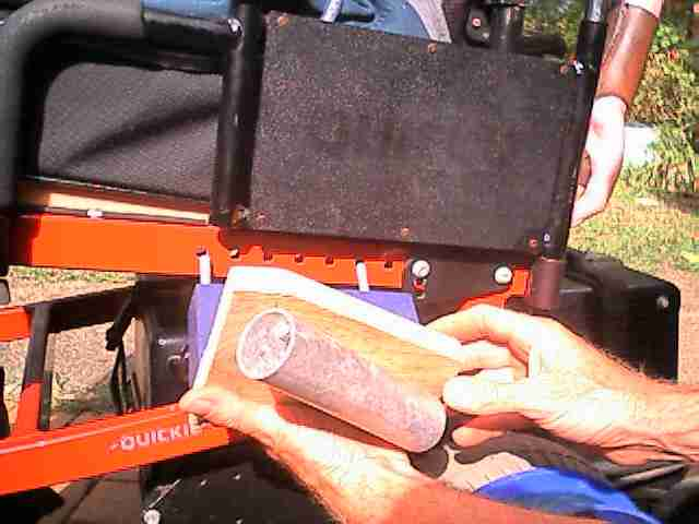 Attaching custom fishing rod holder to wheelchair frame