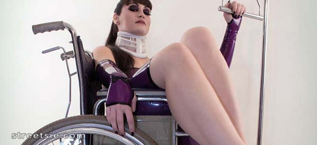 Medical fetish woman in wheelchair and neck brace