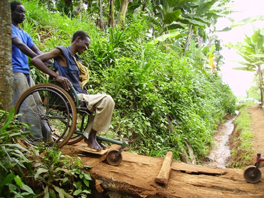Young Man in Africa with Spinal Cord Injury in Donated Wheels out of Poverty Wheelchair